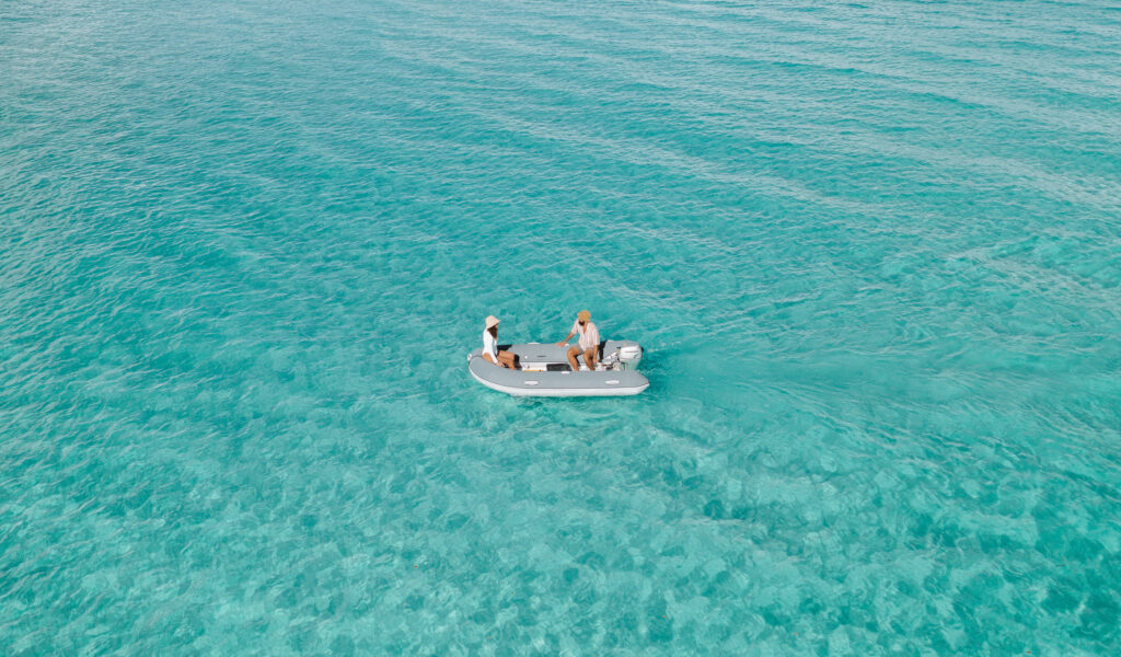Drone photograph of two people in tender